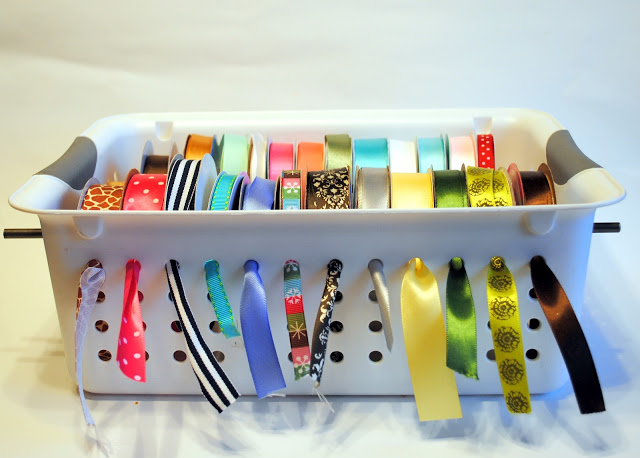 Create a fun ribbon organizer by using the simple bin and a rod