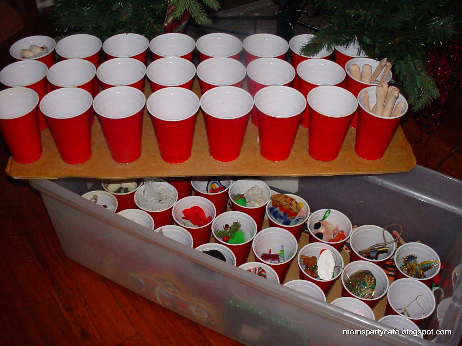 Keep Christmas decorations safe and organized by using cardboard and red plastic cups