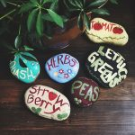 Paint some large rocks and use them as garden markers