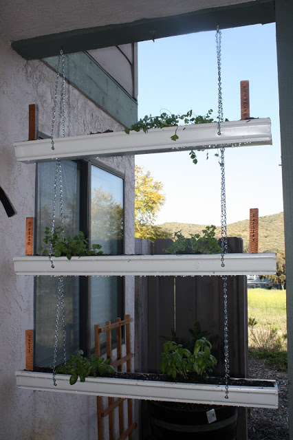 Repurpose Gutters into Hanging Planters