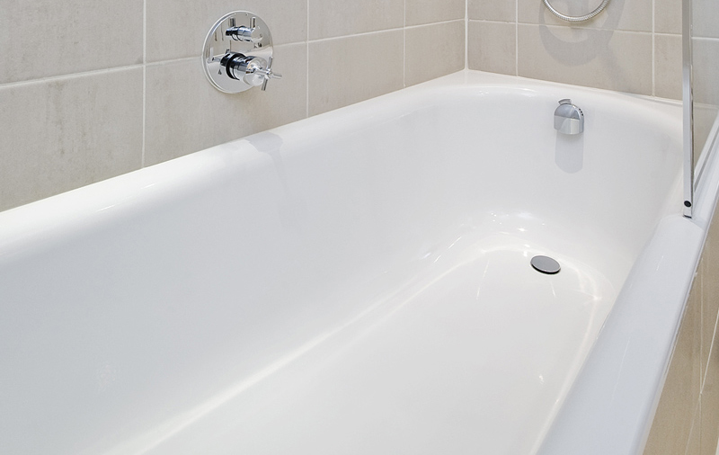Scrub bathtub with a baking soda paste and a scrub brush