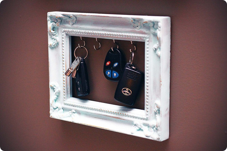 Use a picture frame with installed hooks to store your keys in style