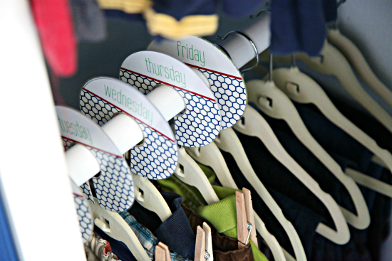 Use hanger tabs to separate clothes into daily outfits