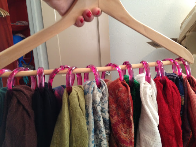 Use shower curtain hooks and a clothes hanger to hang and organize your ties and scarves in the closet