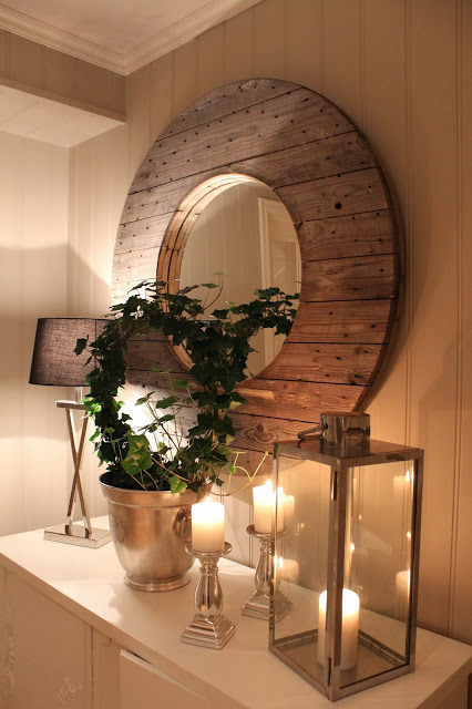 Hallway mirror created from wooden spool