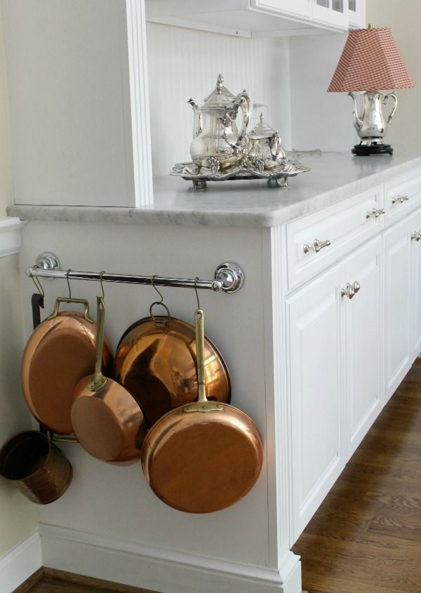 Attach a short rail to the side of your cabinet to magically turn the empty space into storage