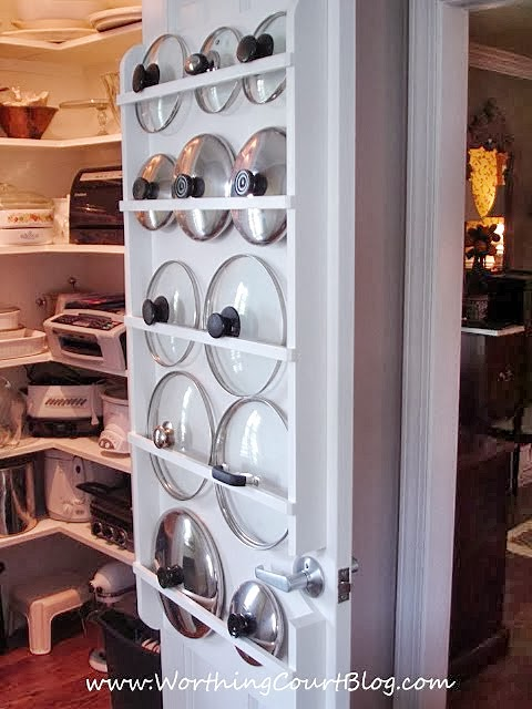 Use curtain rods on the back of pantry door to organize pot lids