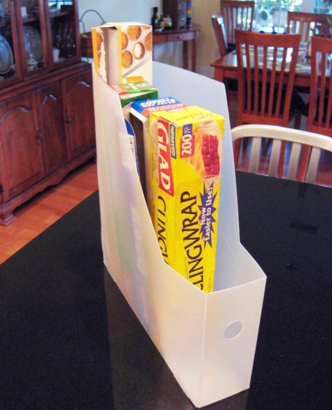Use magazine holders for storing plastic wrap & aluminum foil boxes