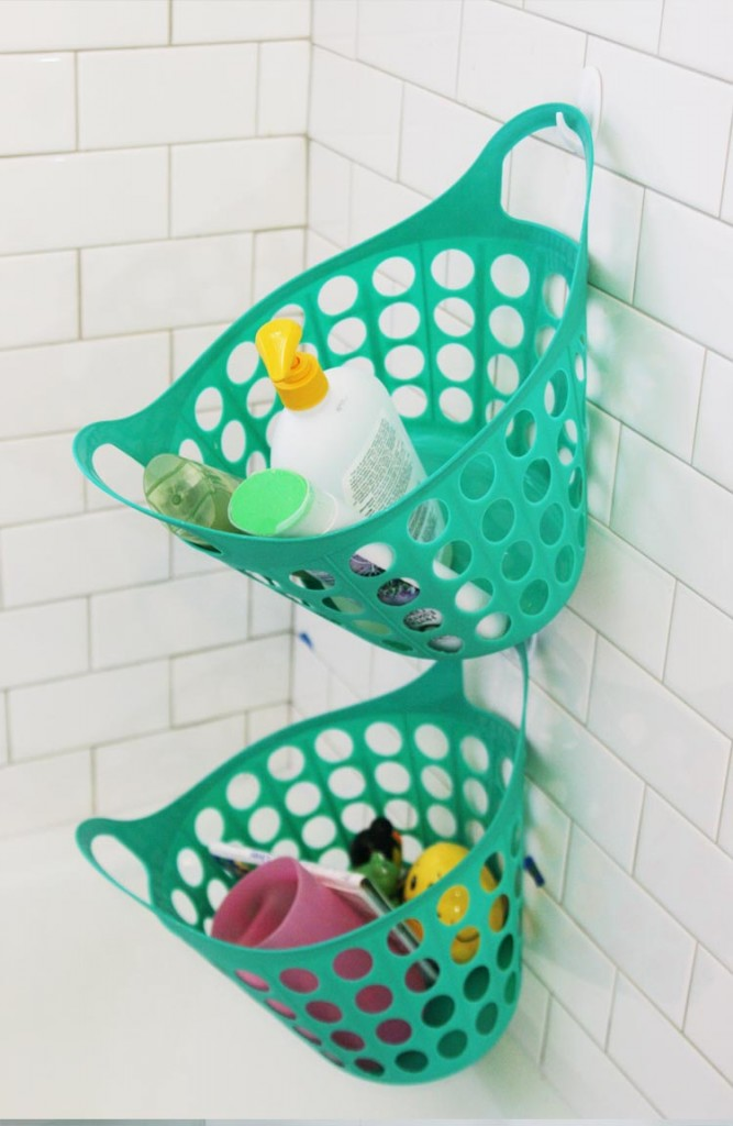 Hang Laundry Baskets On Command Hooks To Keep Your Shower Organized