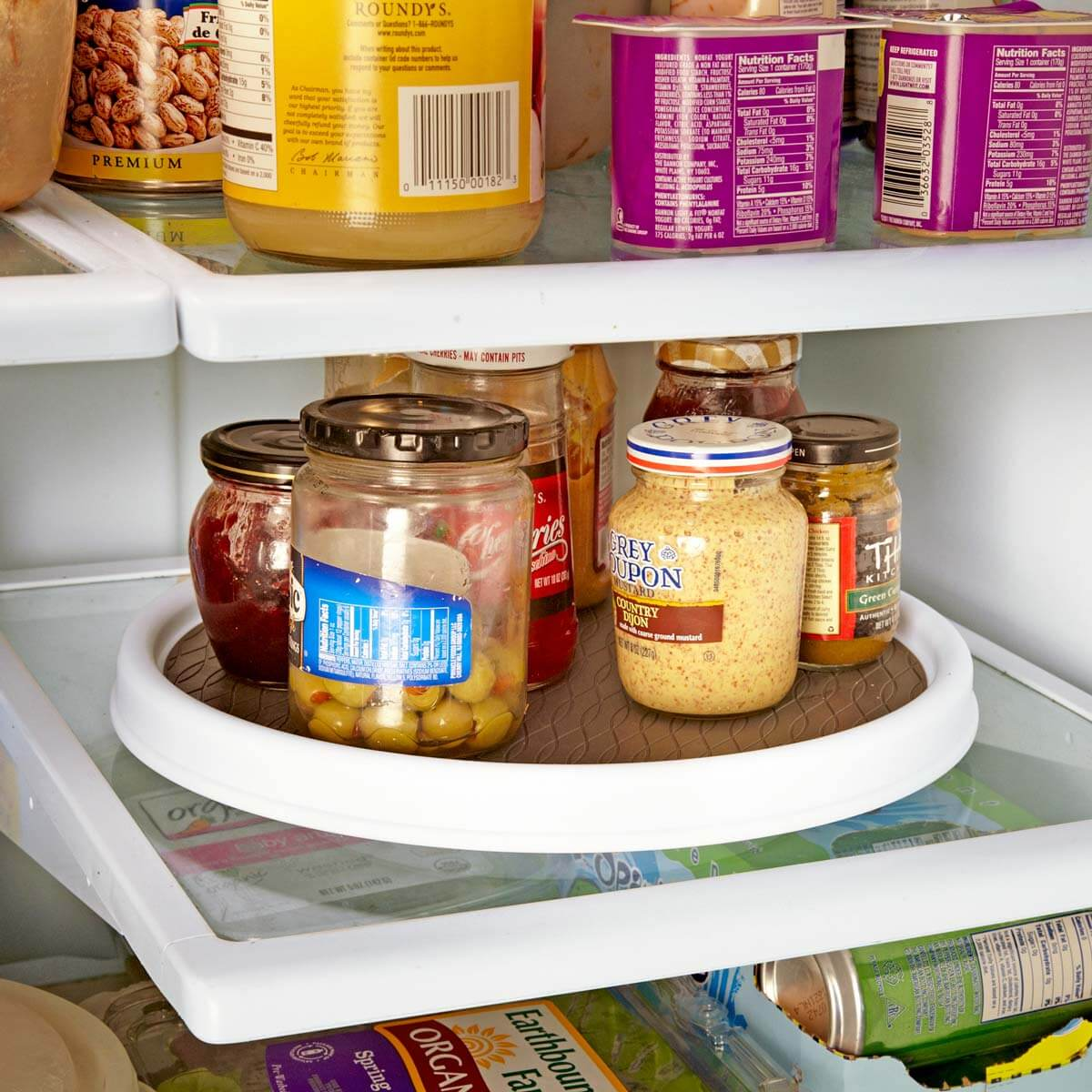 Add a Lazy Susan to the fridge to make small items more accessible