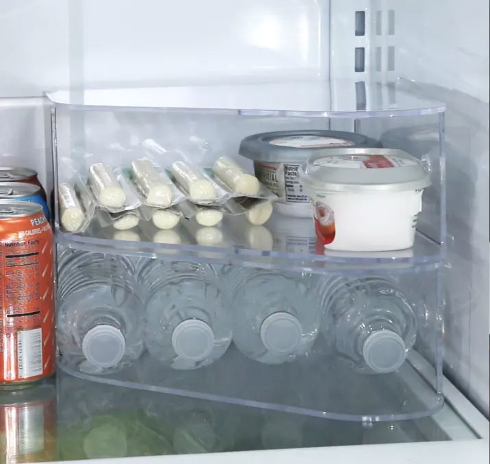 Use file folders to create more space in your fridge or freezer