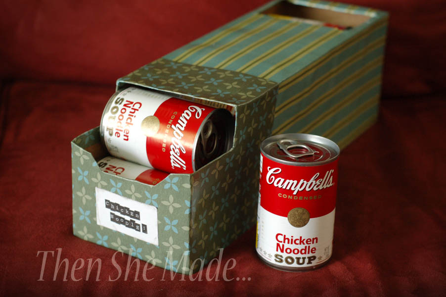 Reuse empty soda boxes to create handy storage for your canned goods