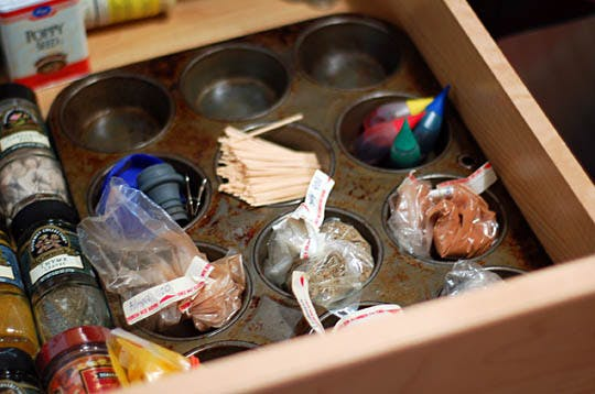 Use an old muffin tin to hold little baggies and other loose containers of spices