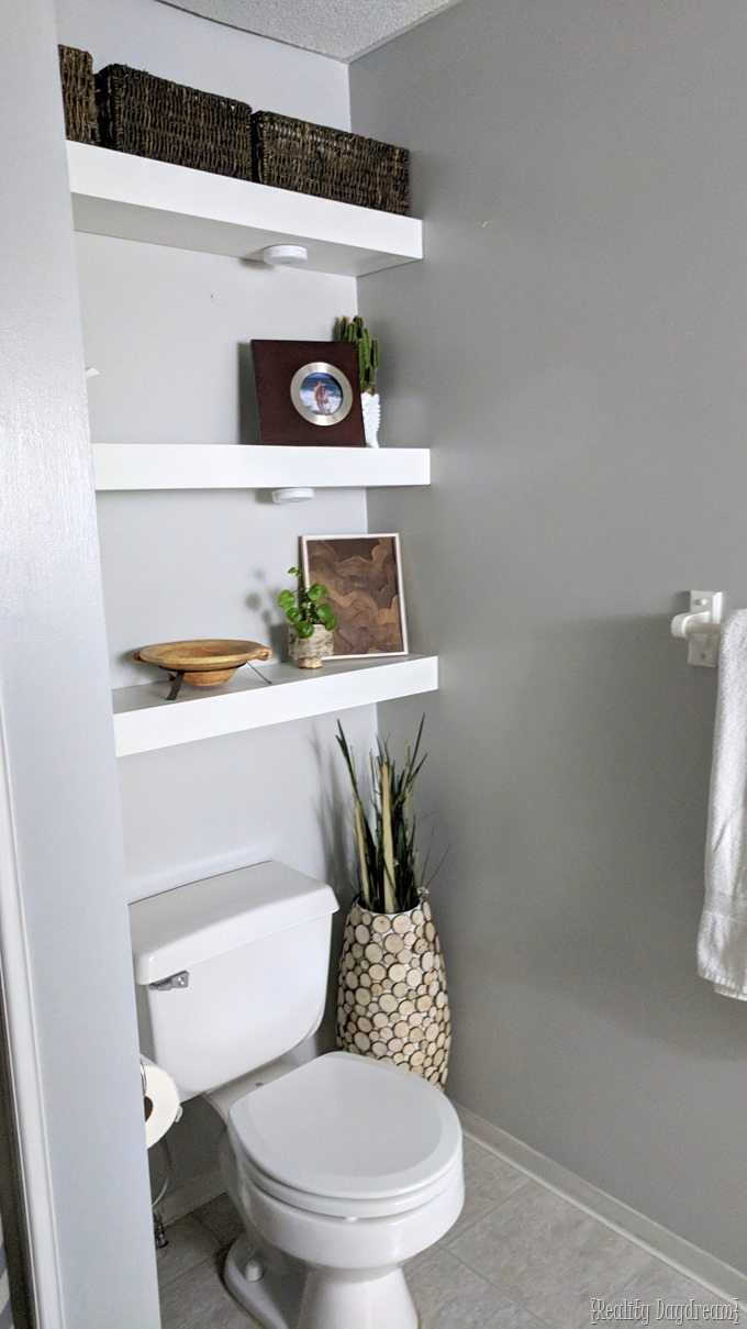 Install floating shelves to use the space above the toilet